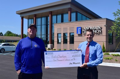 """Landmark Credit Union branch manager, Ryan Hesprich (right), presents Tom """"Mel"""" Stanton (left), executive director of Mel's Charities, with a $1,000 donation to celebrate the opening of the credit union's new Mequon, Wis. branch."""