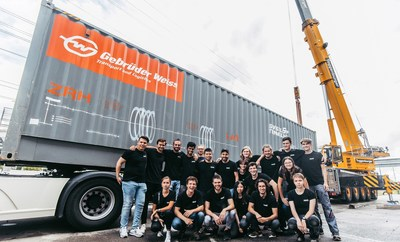 Gebrüder Weiss is the main sponsor of Swissloop Tunneling at ETH Zurich. Here: In front of the Gebrüder Weiss sea freight container in D?bendorf / Switzerland: Stefan Kaspar (left), founder and co-president of Swissloop Tunneling, with his team.