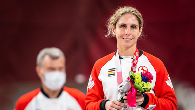 Priscilla Gagné (with coach Andrzej Sadej in the background) smiles after receiving her silver medal in Para judo. PHOTO: Dave Holland/Canadian Paralympic Committee (CNW Group/Canadian Paralympic Committee (Sponsorships))