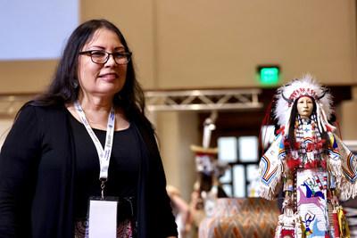 "Best of Show Winner Rhonda Holy Bear Bear (Cheyenne River Sioux) and her winning Doll, ""Lakota Honor- Sees the Horses Woman."" photo©Tira Howard for SWAIA/ Santa Fe Indian Market"